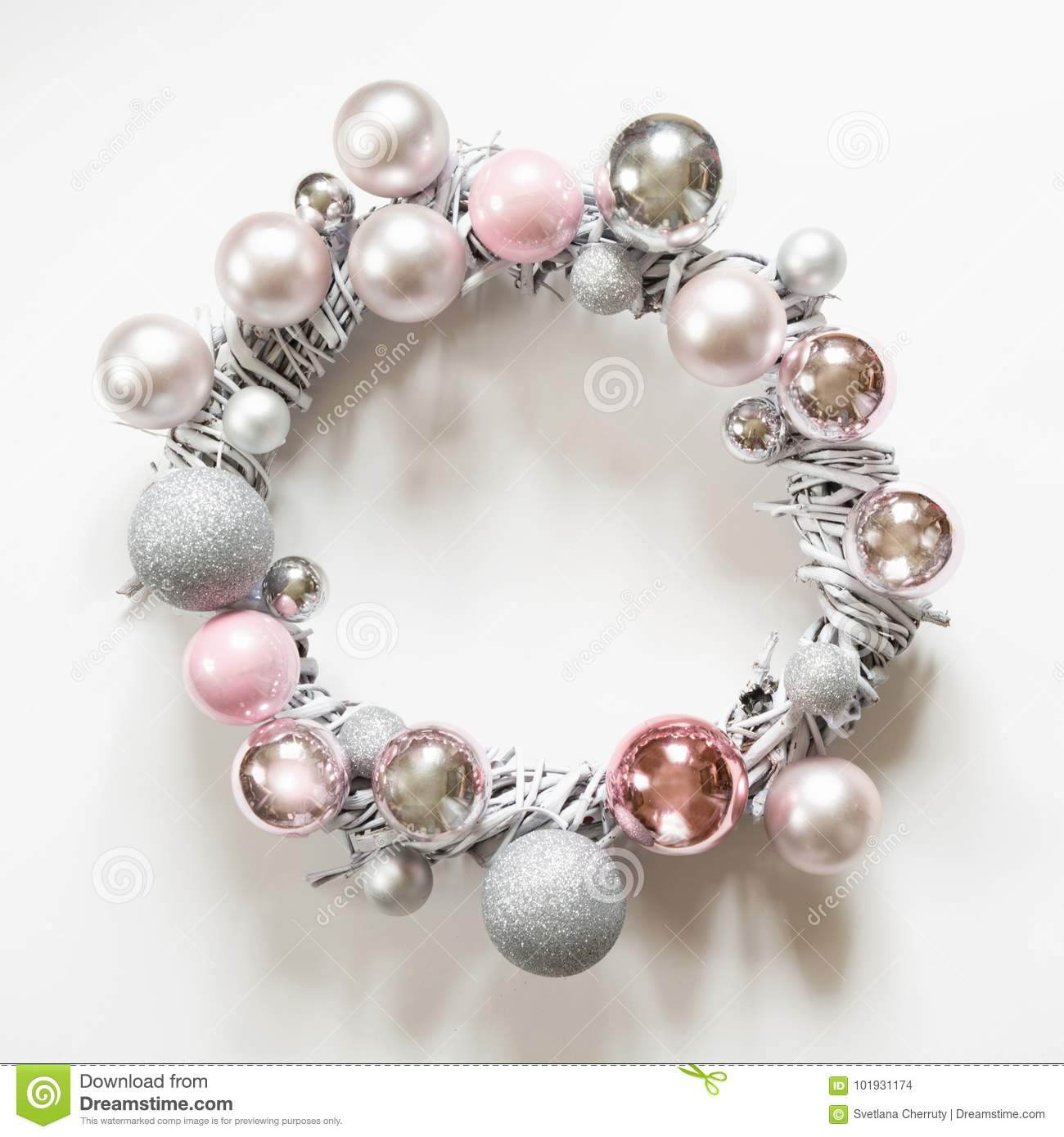 Christmas wreath of decor, silver and pink balls, painted vine on white.