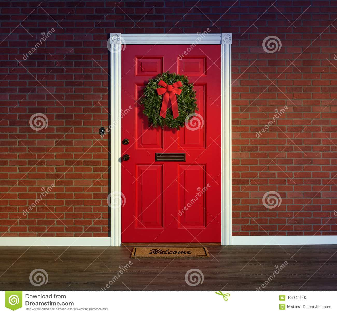 Christmas wreath on red front door with welcome mat.