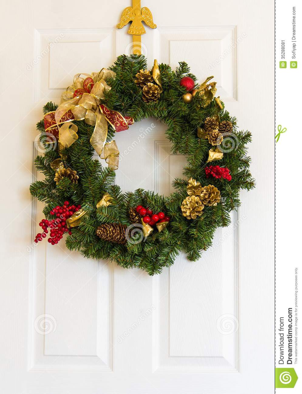 Christmas wreath on door. & Christmas wreath on door. stock image. Image of green - 35288081