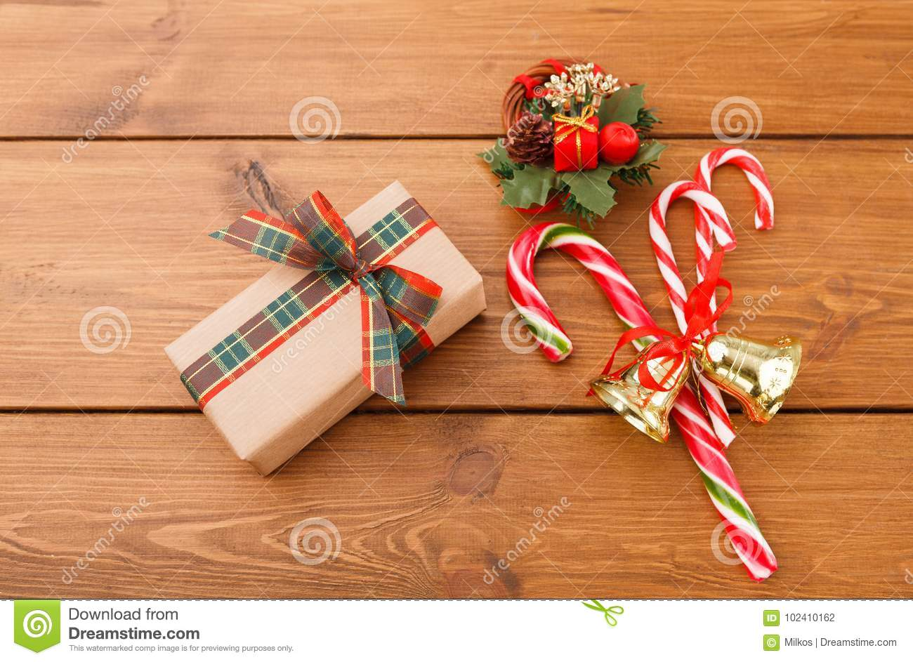 Christmas Wreath Gift Box In Craft Paper And Xmas Candy On Rustic Wood Background Stock Photo Image Of Christmas Star 102410162