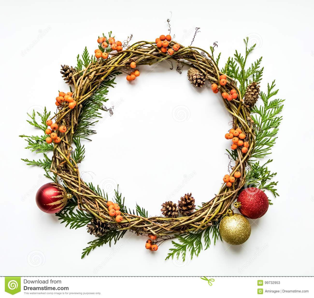 Christmas wreath of vines with decorative ornaments, thuja branches, rowanberries and cones. Flat lay, top view