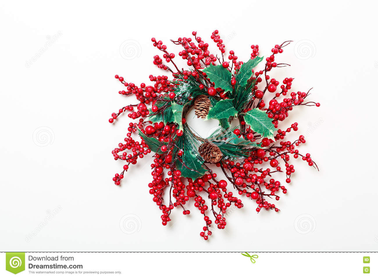 Christmas wreath of holly berries and evergreen isolated on white background