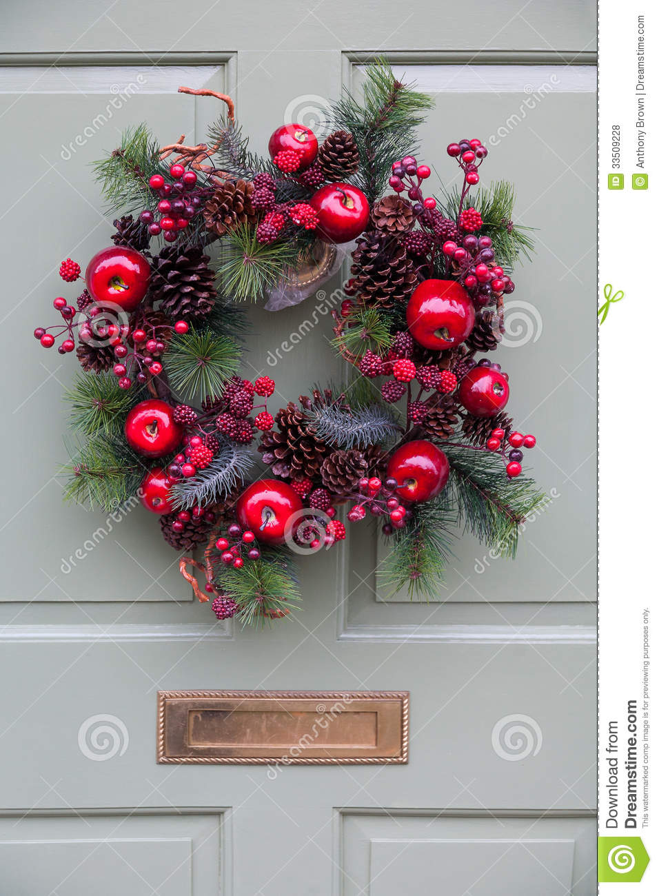 Christmas Wreath On A Pale Green Door Stock Photo Image Of Cones