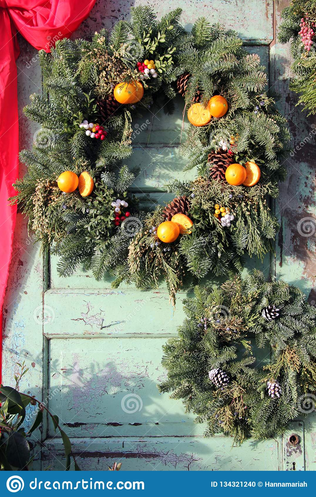 Christmas wreath with pinecones and oranges