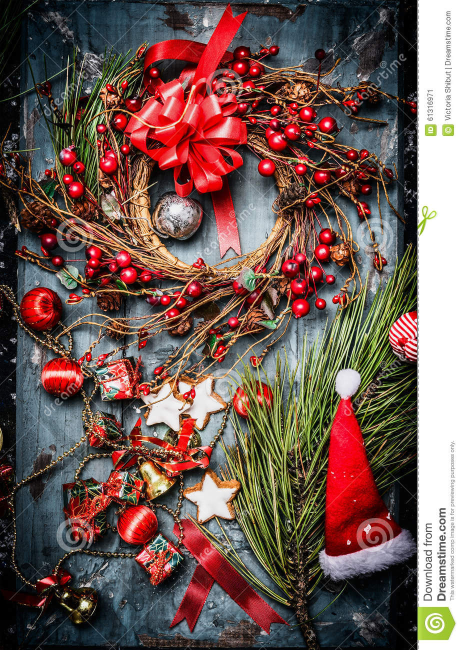 Christmas wreath with red holiday decorations and santa