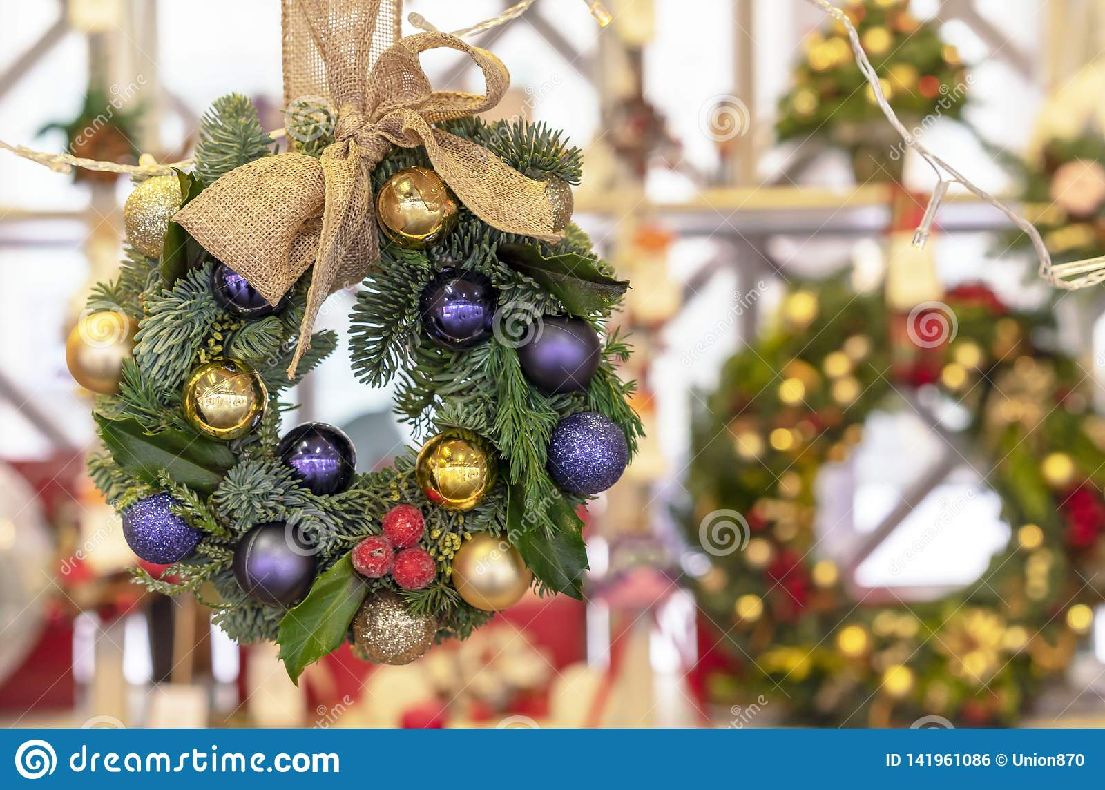 Christmas wreath of spruce, purple and gold balls
