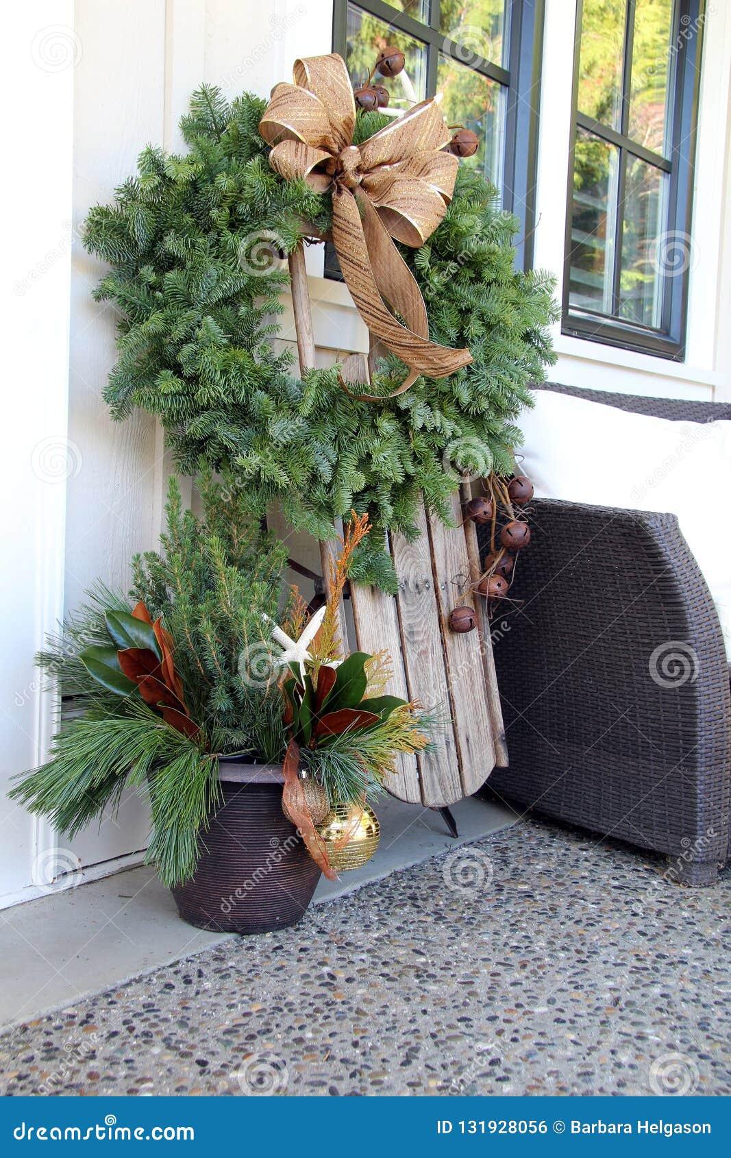 Christmas wreath and sled