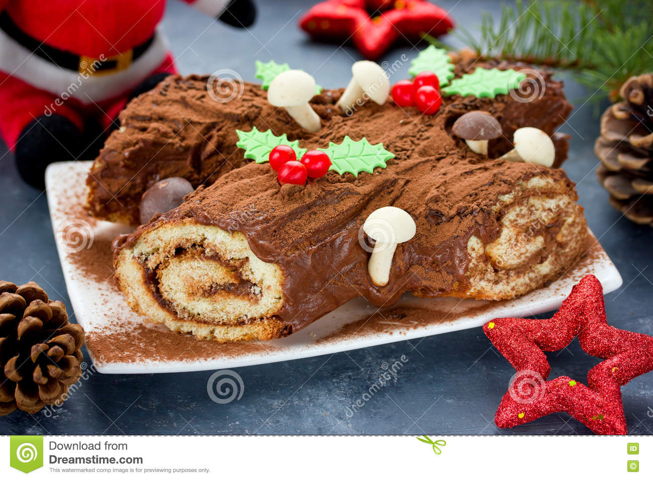 Christmas Yule Log Cake Decorated With Chocolate Holly Mushrooms