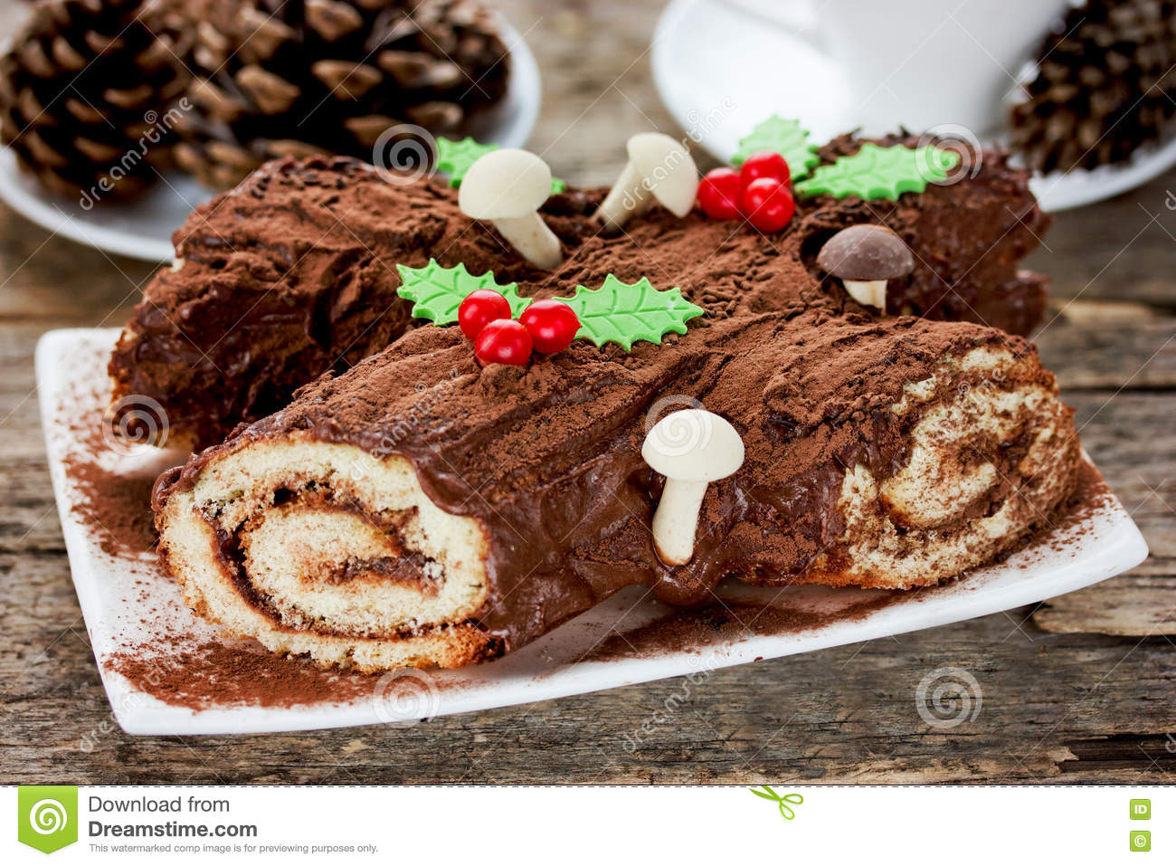 Christmas Yule Log Cake.Christmas Yule Log Cake Decorated With Chocolate Holly