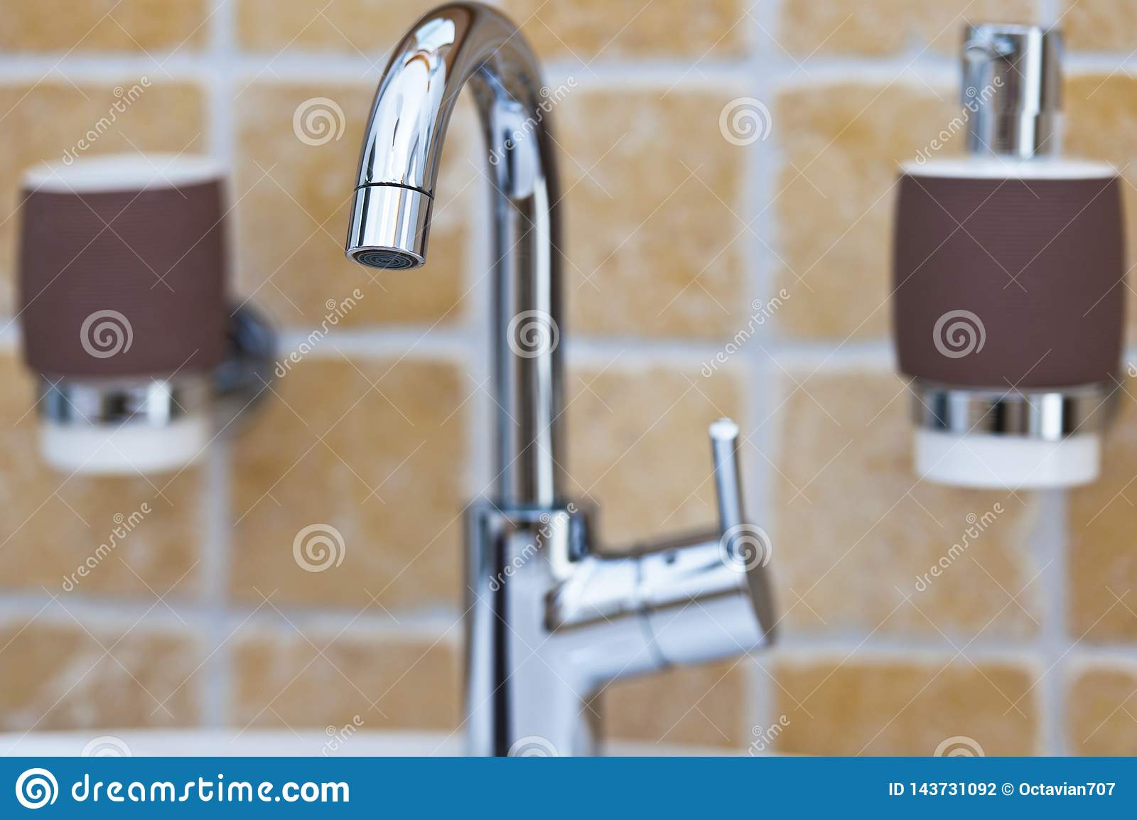 Chrome mixer tap in bathroom