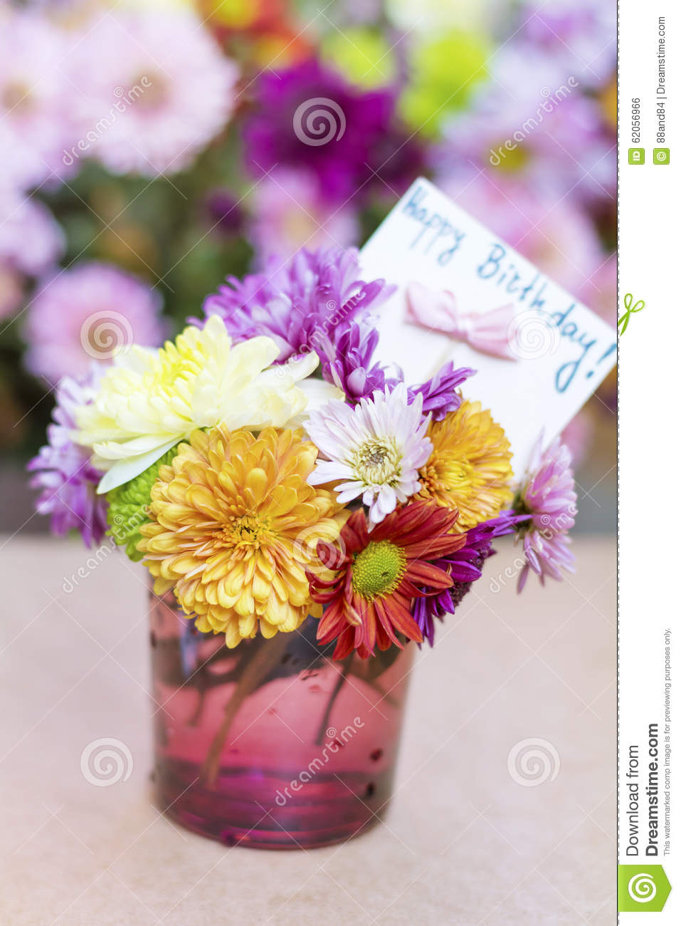 Chrysanthemums Flowers In Purple Glass Vase With Happy Birthday Card