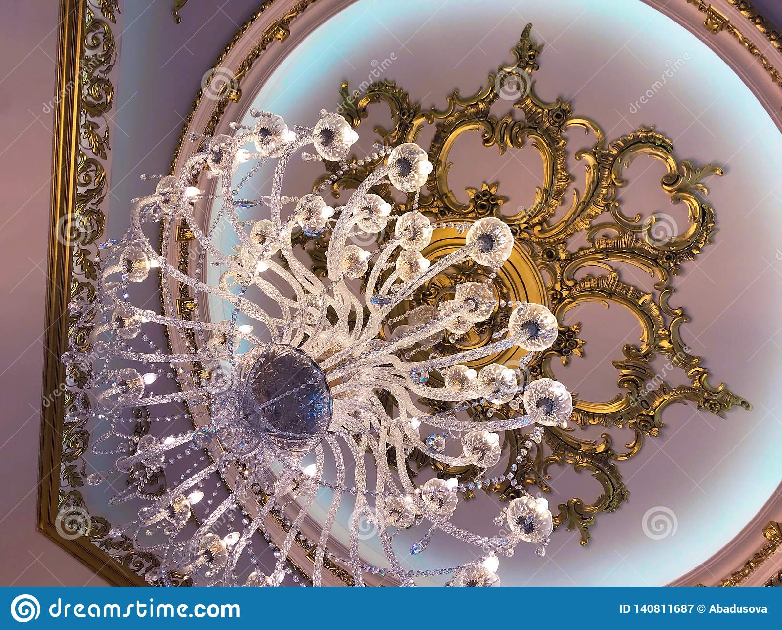 Chrystal chandelier lamp on the ceiling in Dining room Adjusting the image in a Luxury tone .Decorative elegant vintage
