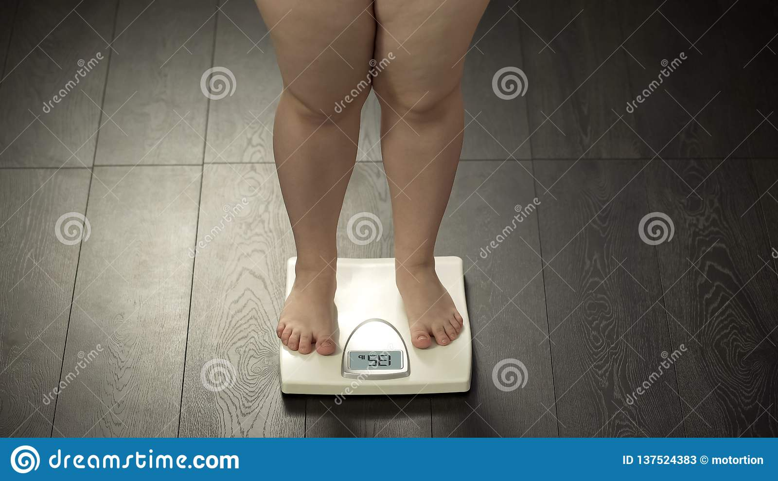 Chubby Woman Standing On Home Scales  Normal Weight