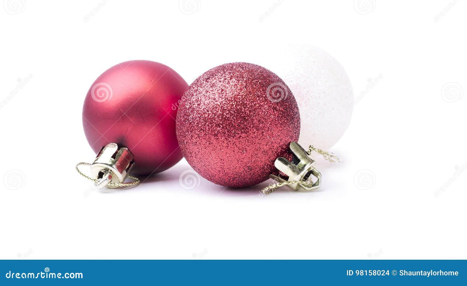 Chucherías de la Navidad roja y blanca del brillo brillante aisladas en un puro