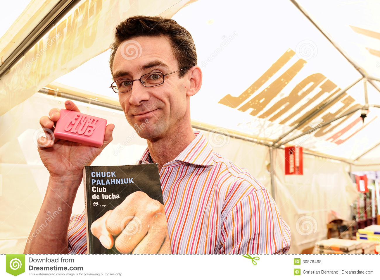 Chuck Palahniuk, author of the novel Fight Club, which also was made into a feature film, signs books in the streets of Barcelona