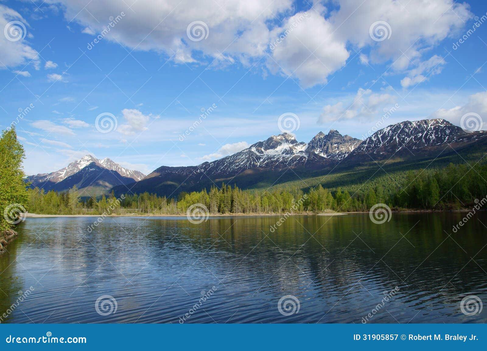 Chugach mountains and reflections lake alaska royalty free for Peak fishing times