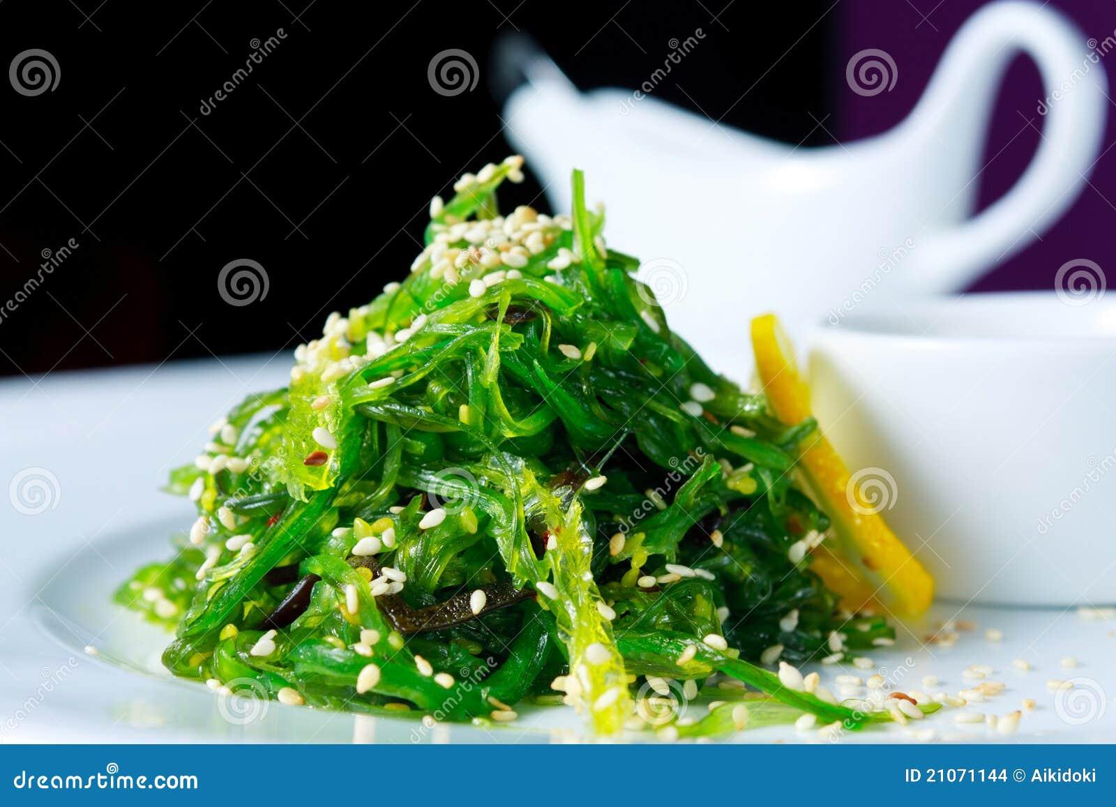 Chuka seaweed salad garnished with sesame seeds and lemon. Japanese ...