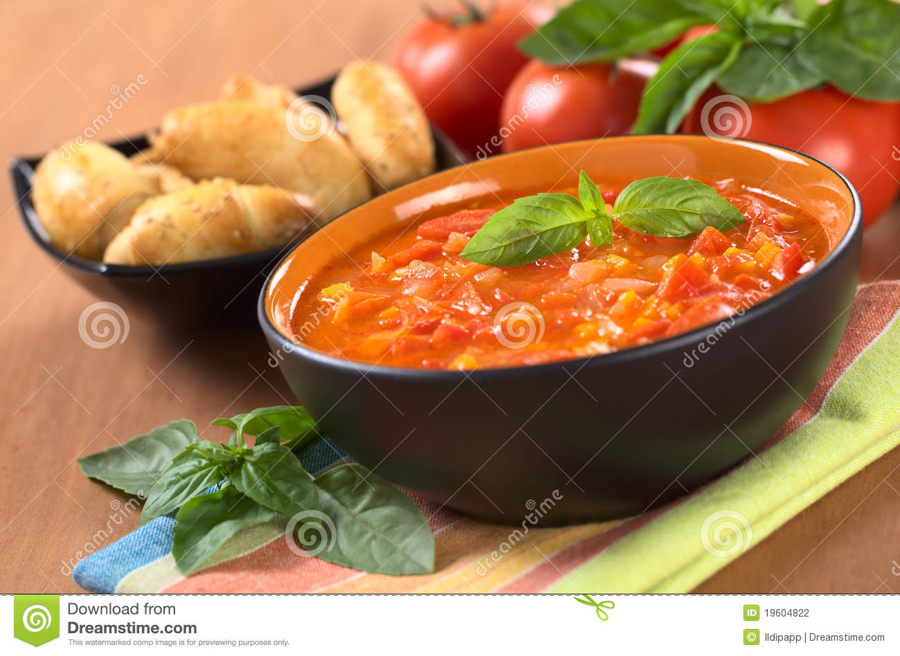 Chunky tomato soup made of tomatoes, carrots and onions and garnished ...