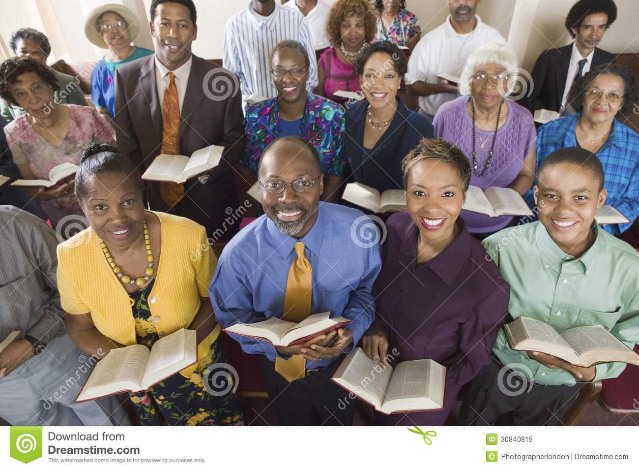 Church congregation sitting on church pews with Bible portrait high angle view