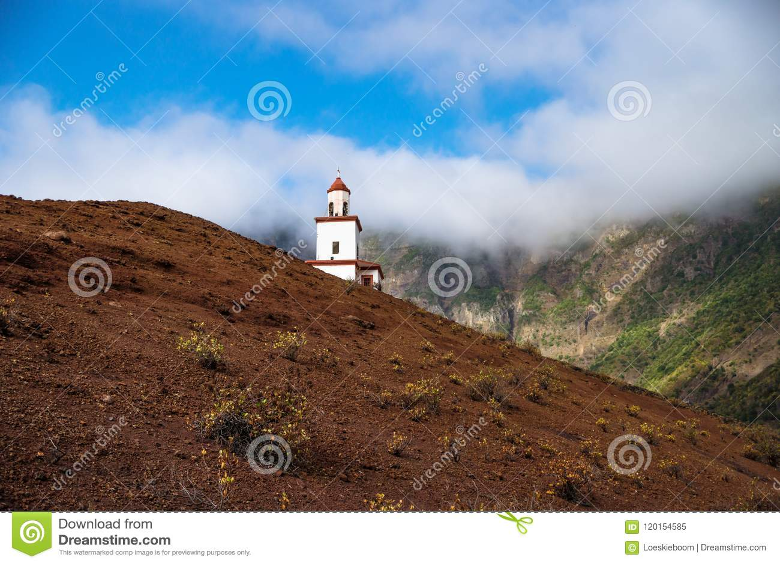 The church La Candelaria on a slooped red hill, Frontera, El Golfo, El Hierro, Canary Islands, Spain