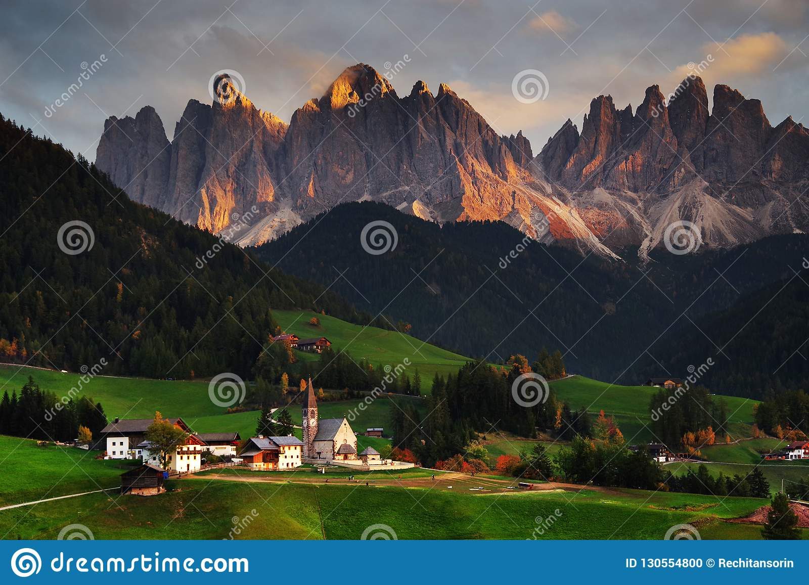 The church Santa Maddalena with the impressive Odle Mountains Group in the background, at sunset.