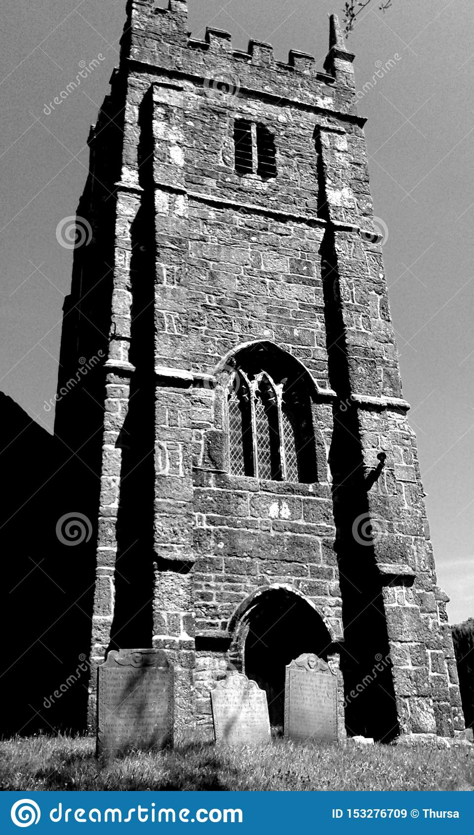 Church tower and tombstones, England