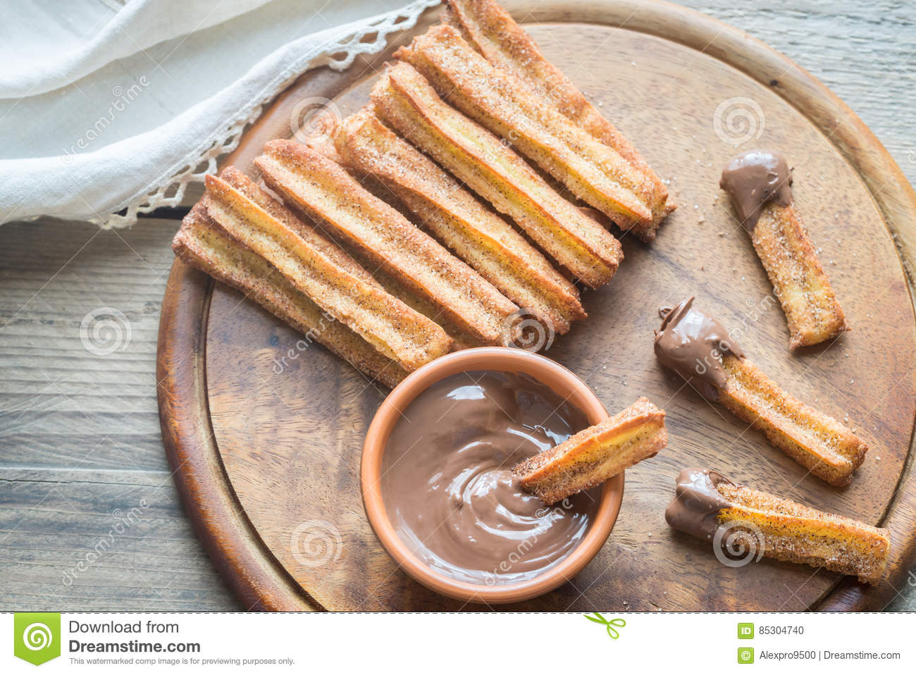 Churros - famous Spanish dessert with chocolate sauce