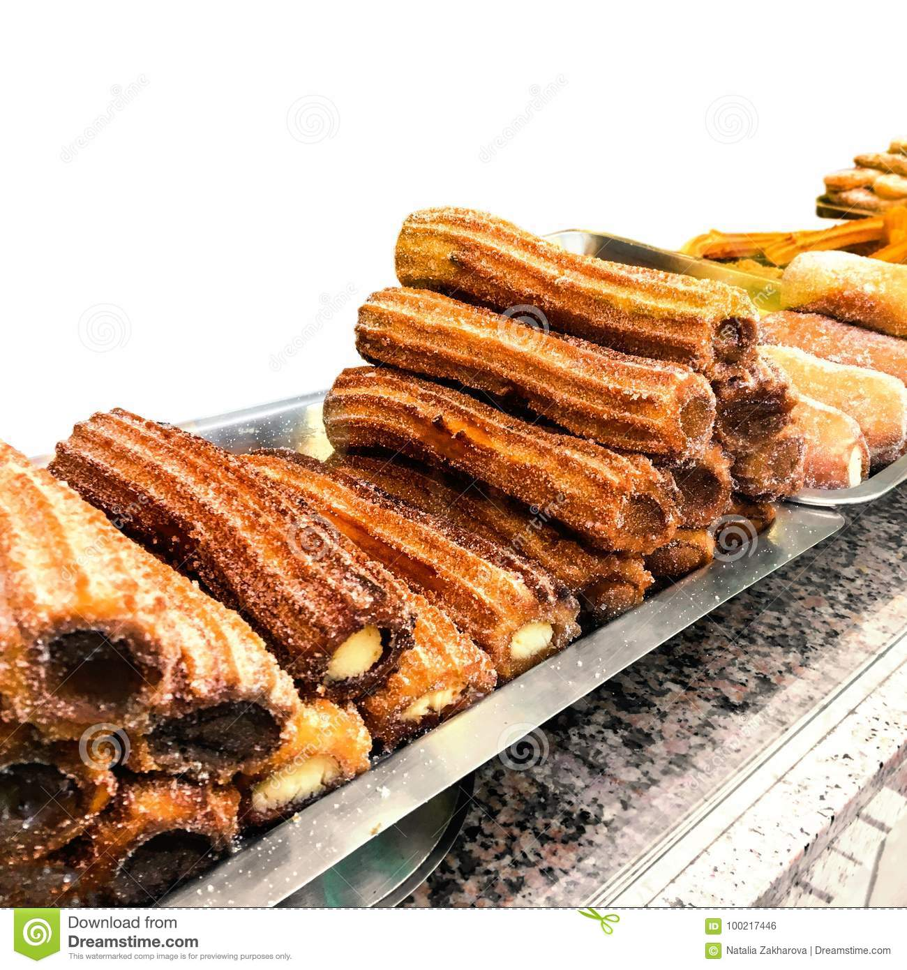 Churros on a market stall in a bakery shop. Sweet Famous Spanish