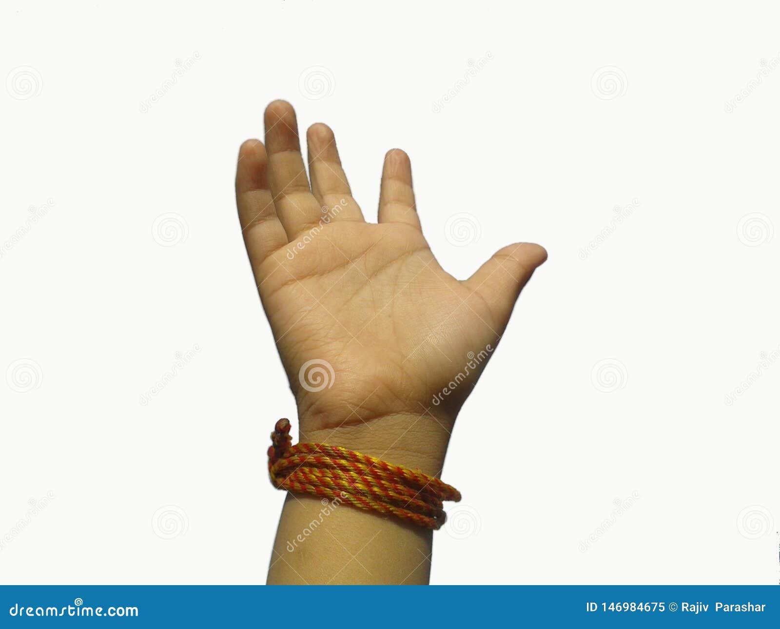 Ciò è l immagine della mano del bambino con il fondo bianco del percorso felice