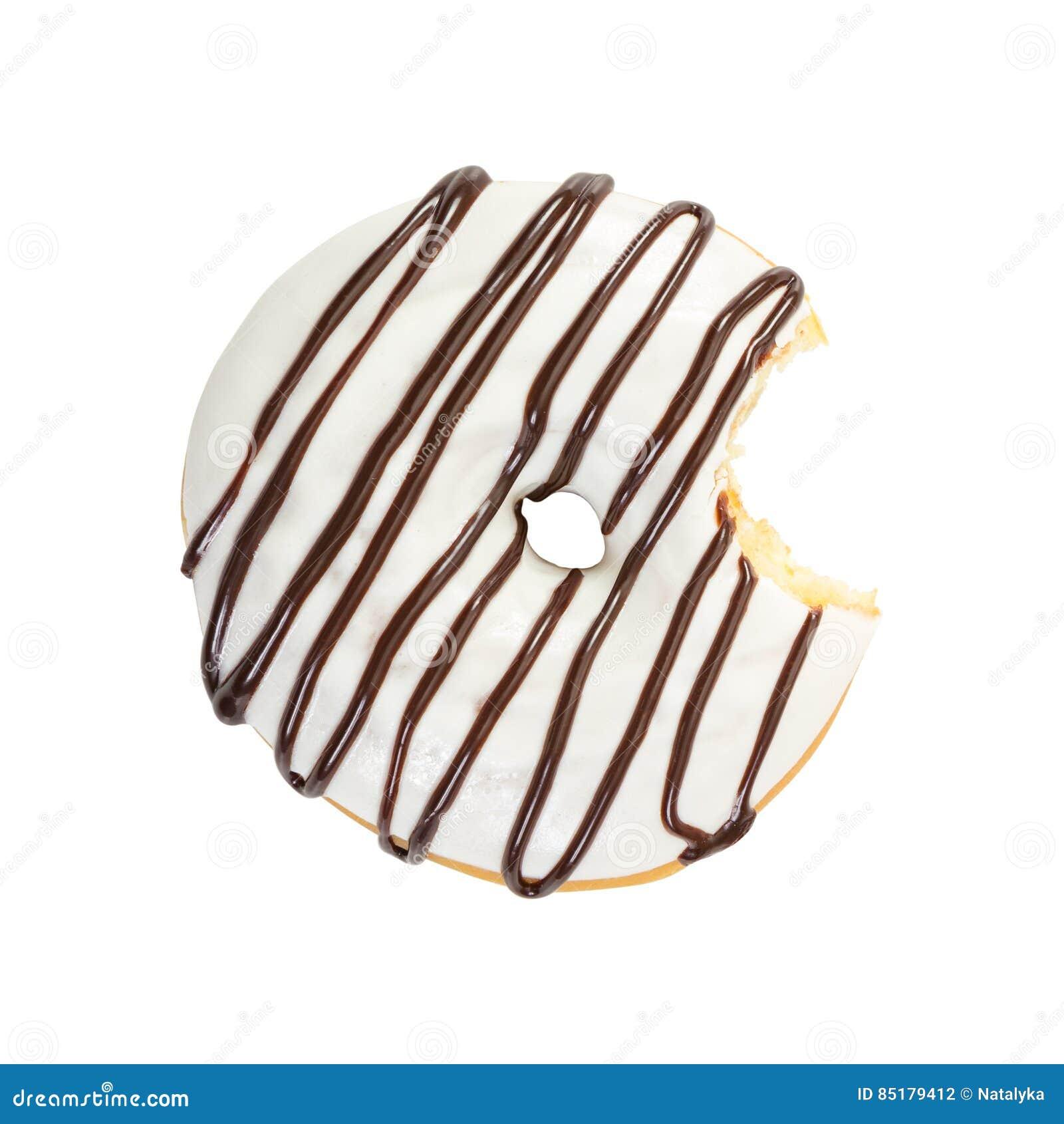 Ciambella pungente con lo sciroppo bianco di cioccolato e della glassa