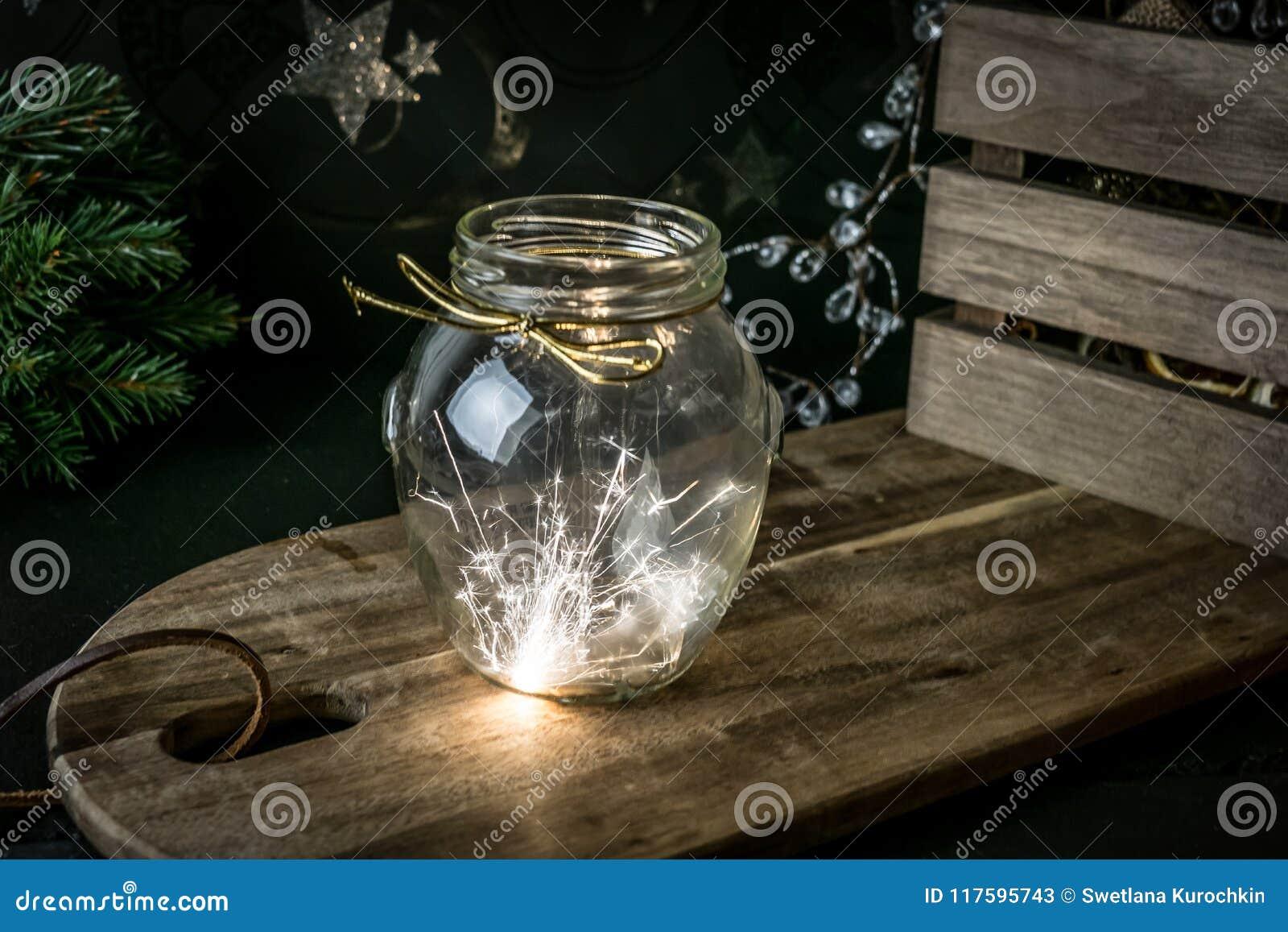 Cierge magique dans le pot de glas