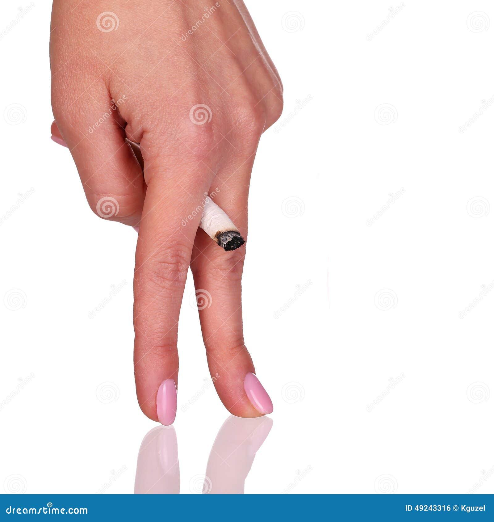 Cigarett i handen som symboliserar impotens som isoleras