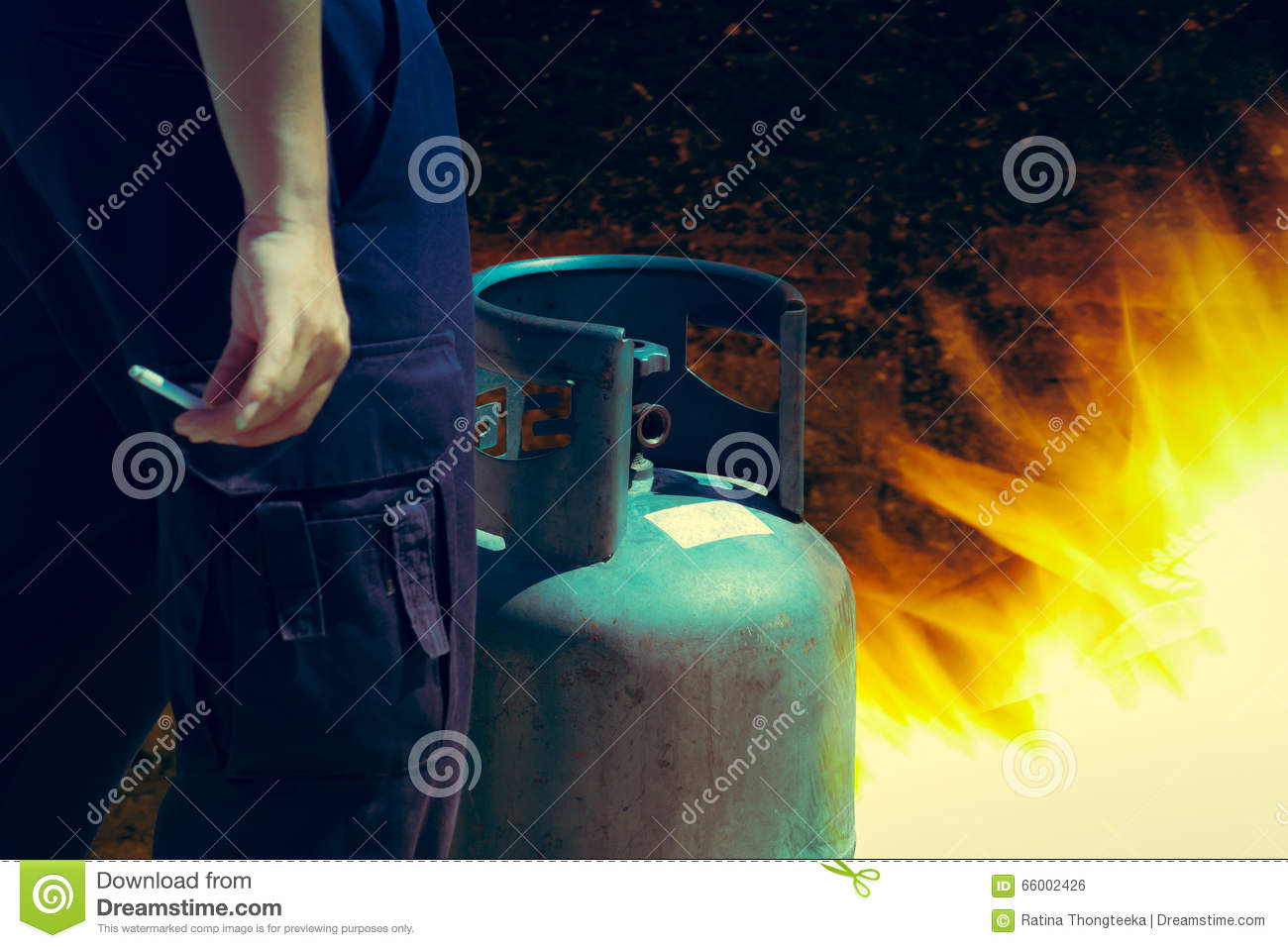 Cigarette in hand near gas tank cylinder can ignition of flammable, safety concept