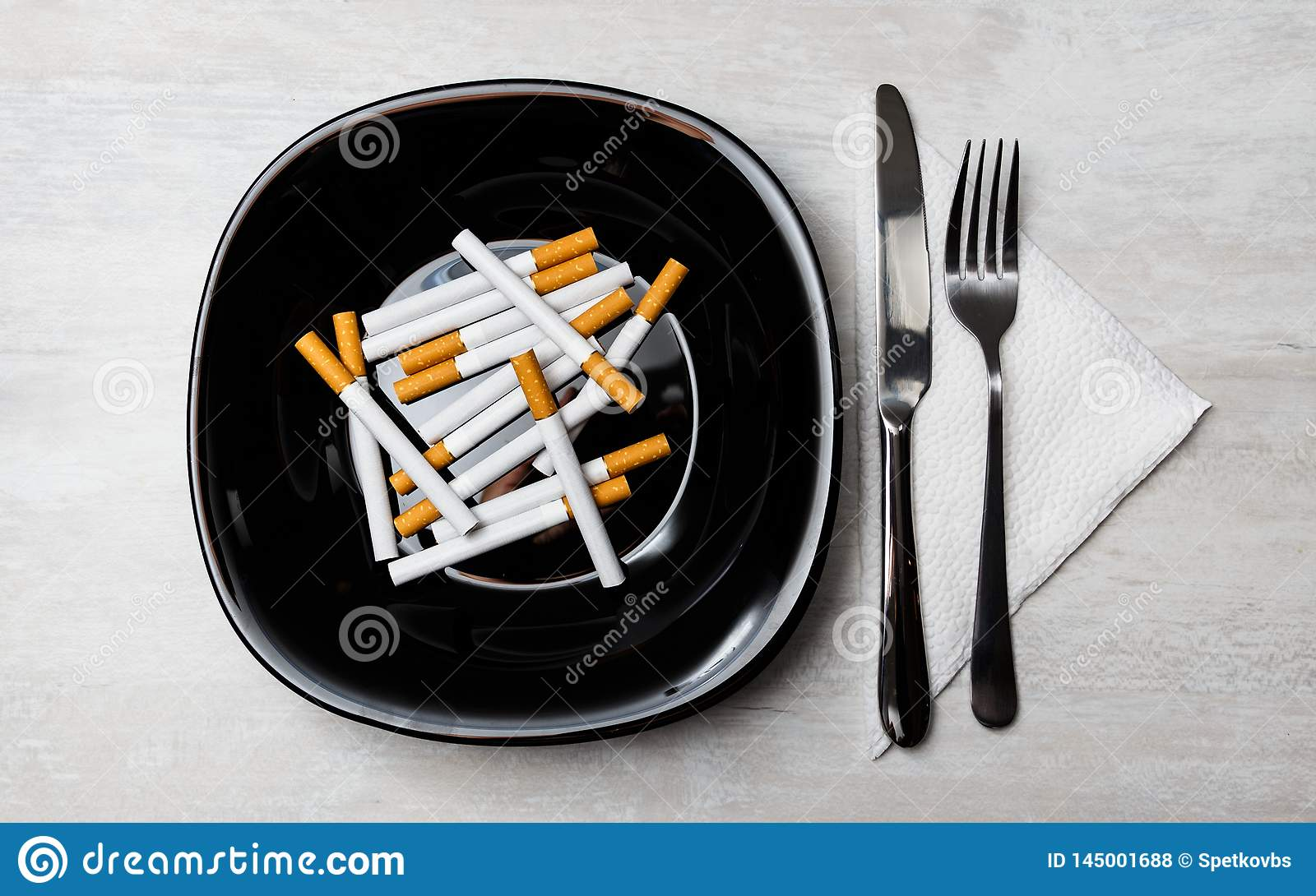 Cigarettes meal with fork and knife
