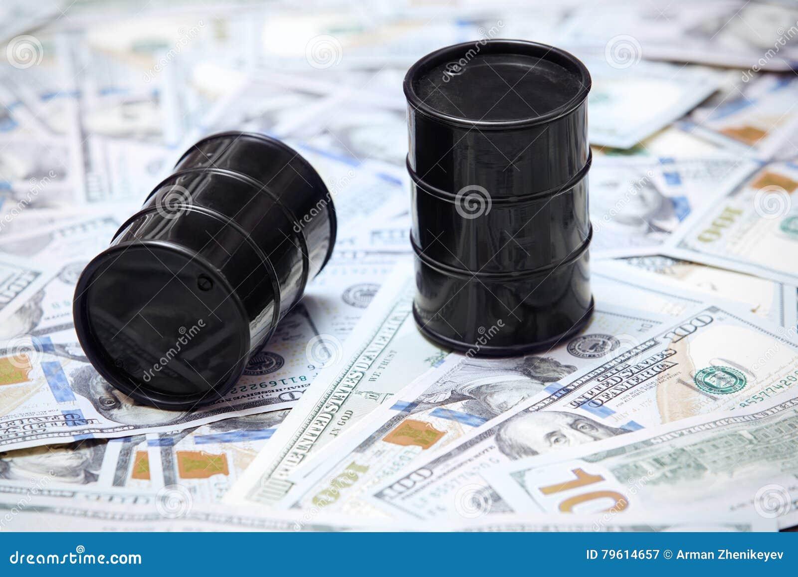 Cilindros de óleo no fundo dos dólares americanos