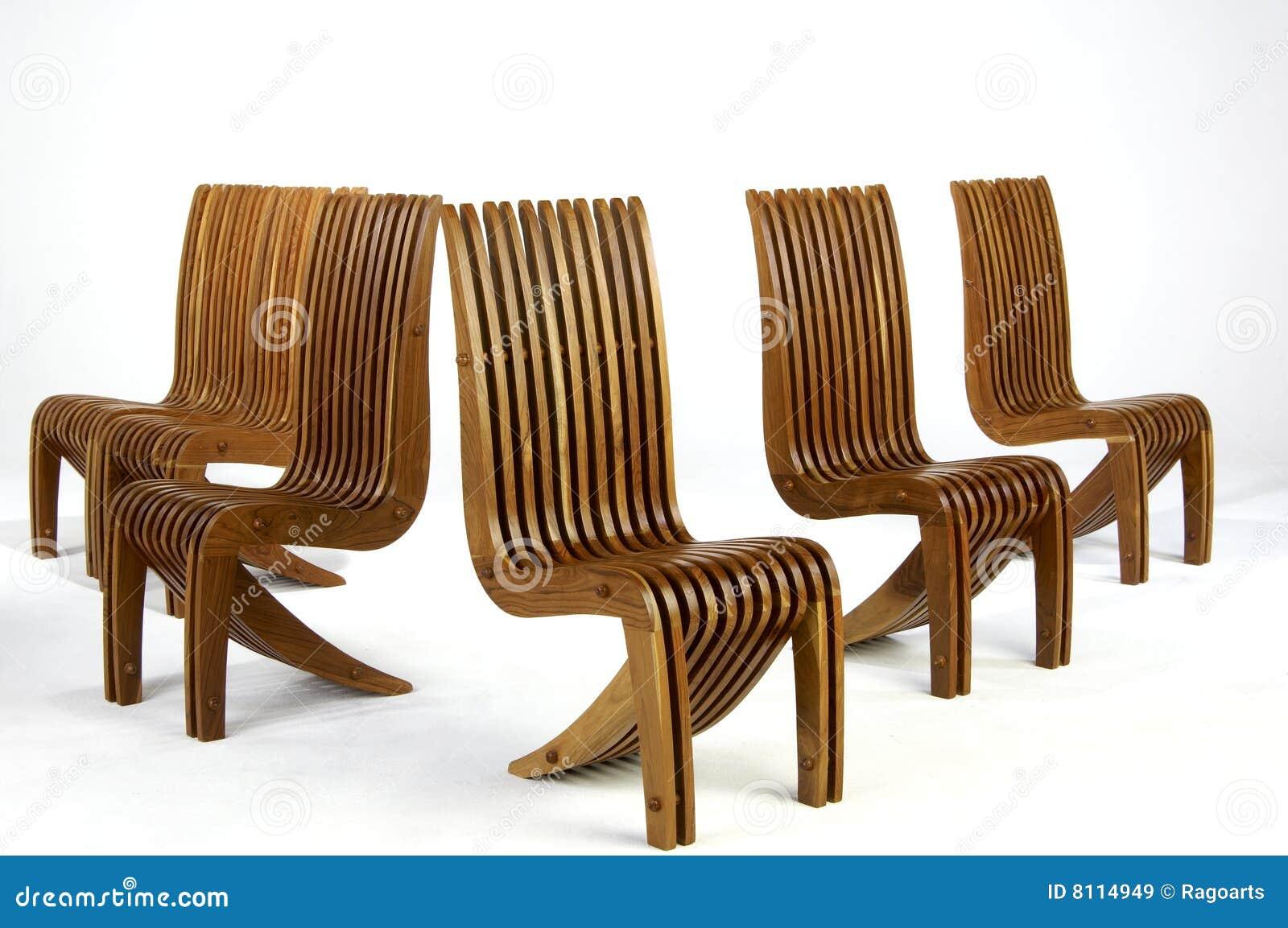 Cinco sillas laterales de madera del dise o moderno imagen for Tapizados de sillas modernas