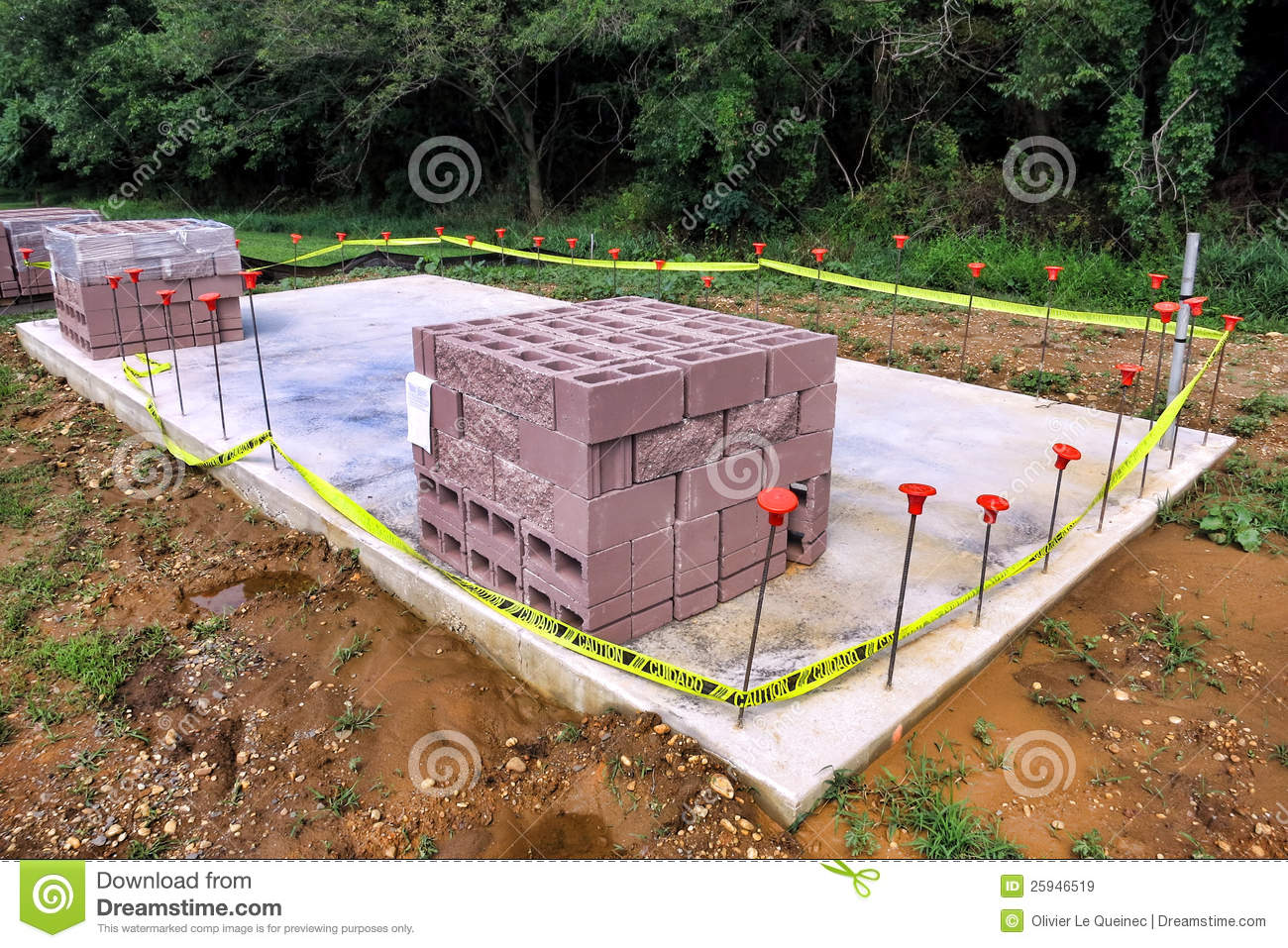 Cinder block on concrete slab at construction site royalty for Cinder block house construction
