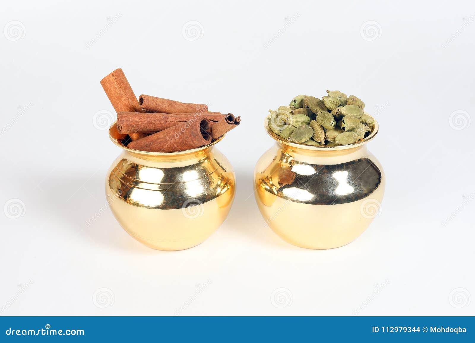 Cinnamon cardamom spice in shiny metal pot