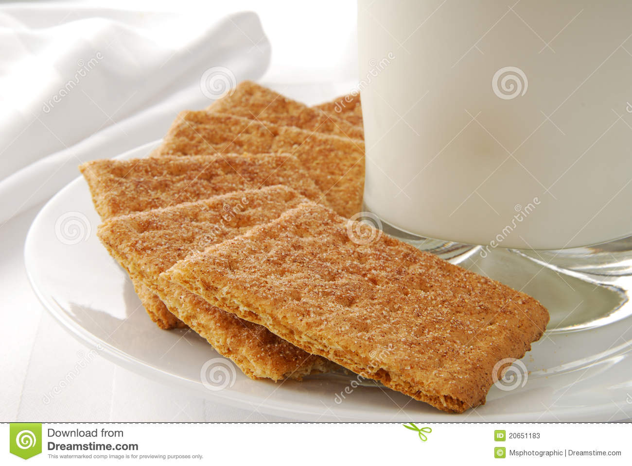 plate of cinnamon sprinkled graham crackers and a glass of milk ...