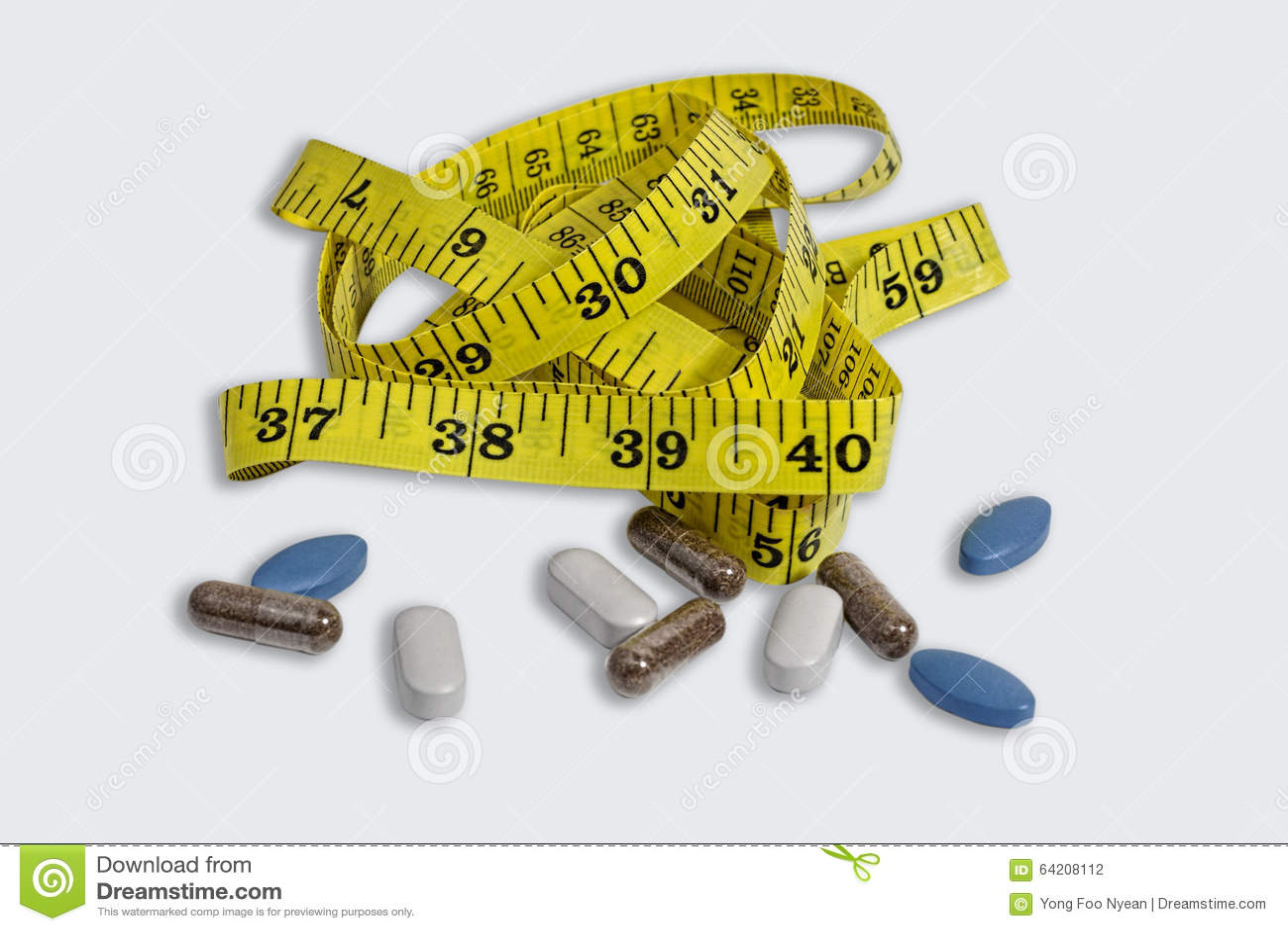 Cinta de la medida con las píldoras, las tabletas y la cápsula