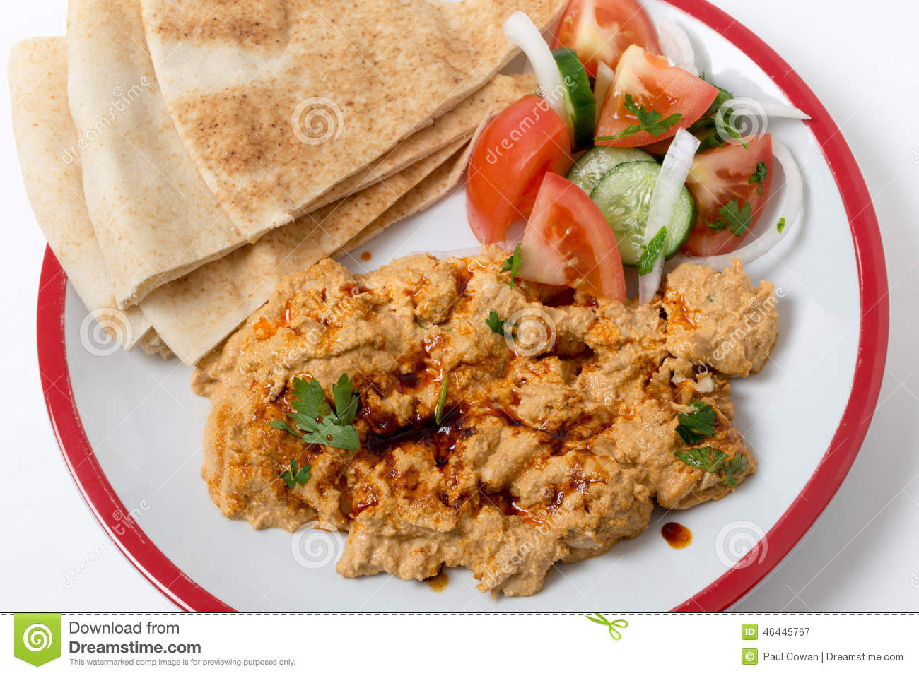Circassian chicken with salad and bread seen from above