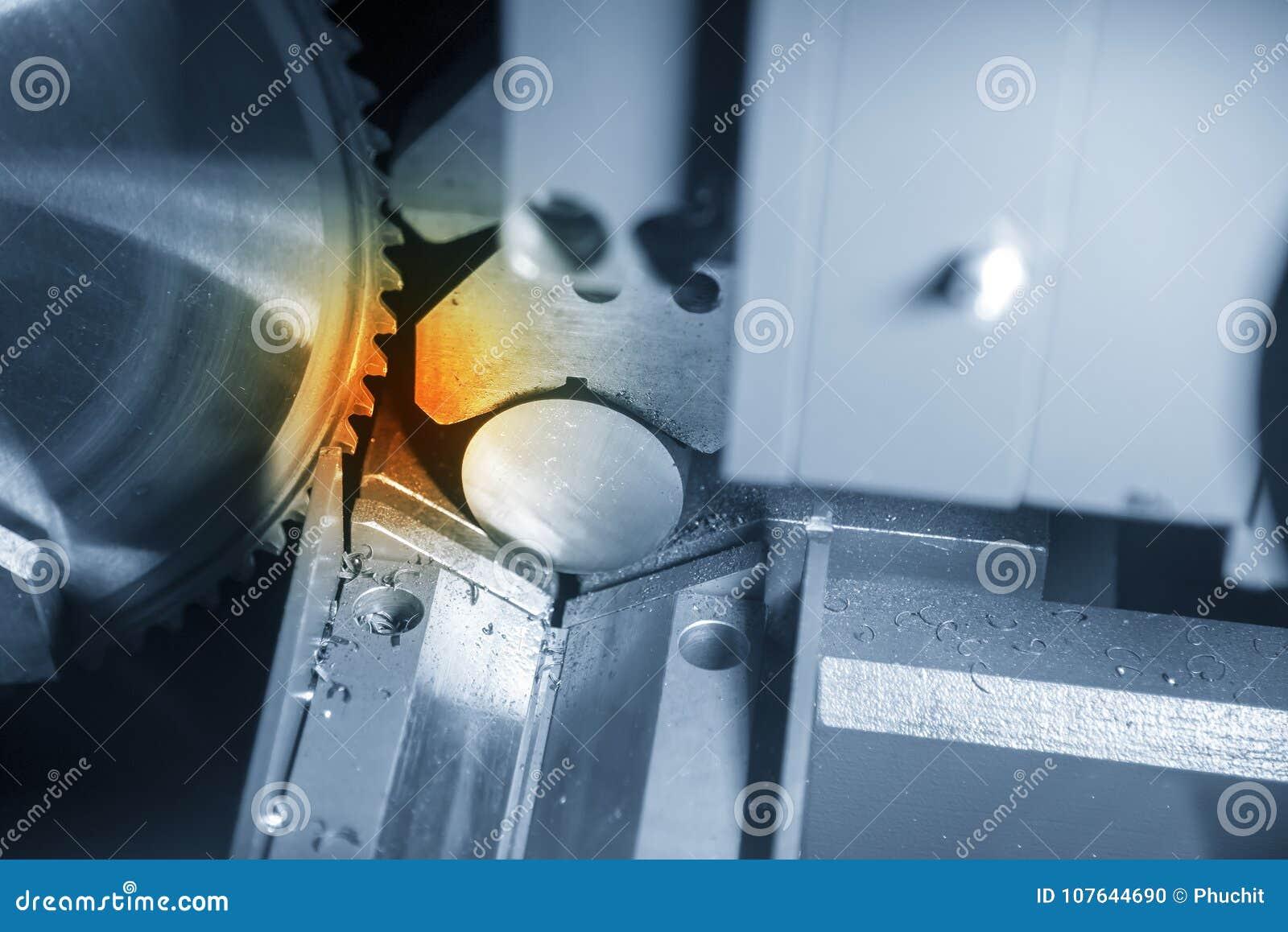 The circular saw machine cutting the metal rod.