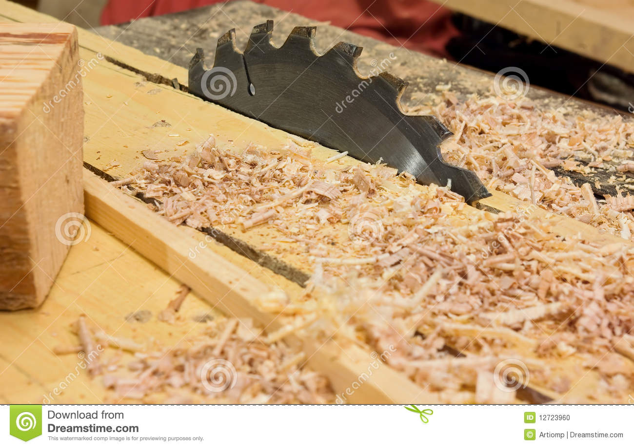Working In Sawdust ~ Circular saw and sawdust in workshop stock photo image