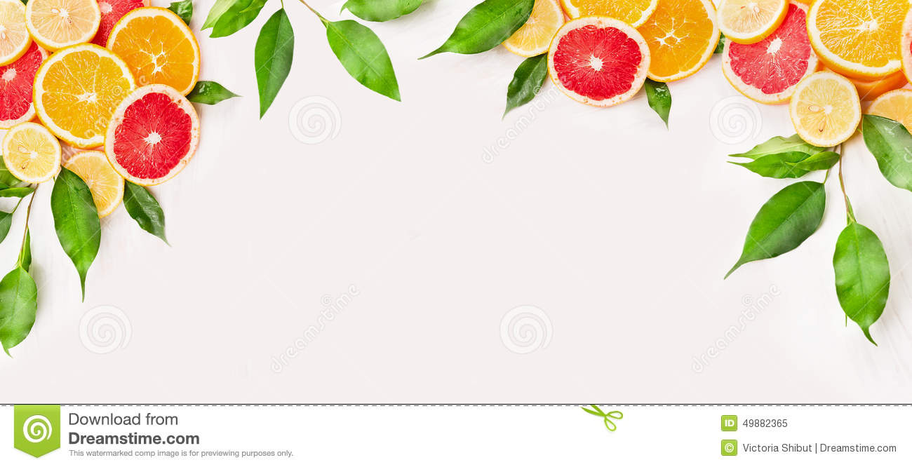 Citrus fruits slice with green leaves on white wooden background, banner