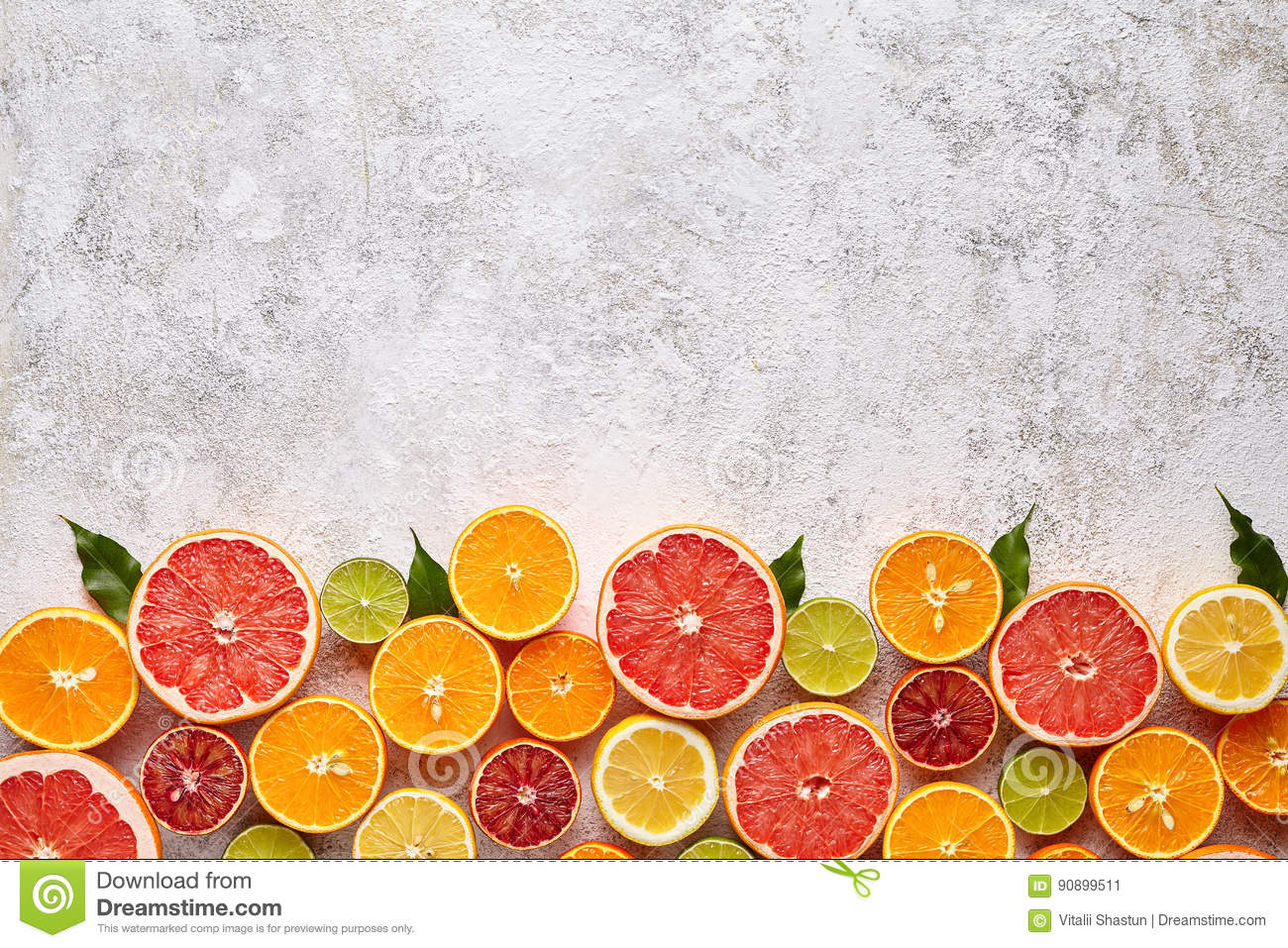 Citrus fruits vegan mix flat lay on white background, helthy vegetarian organic food