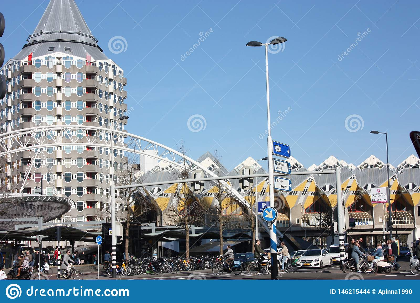 Daily city chaos in the hectic and modern station of the metropolis of Rotterdam. Yellow cubic houses are the decoration of the