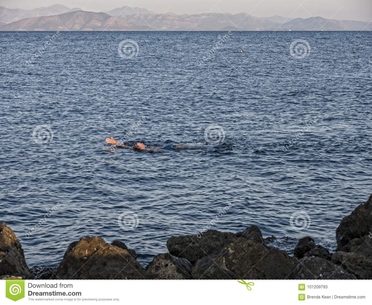 Swimming In The Bay Of Corfu Town On The Greek Island Of