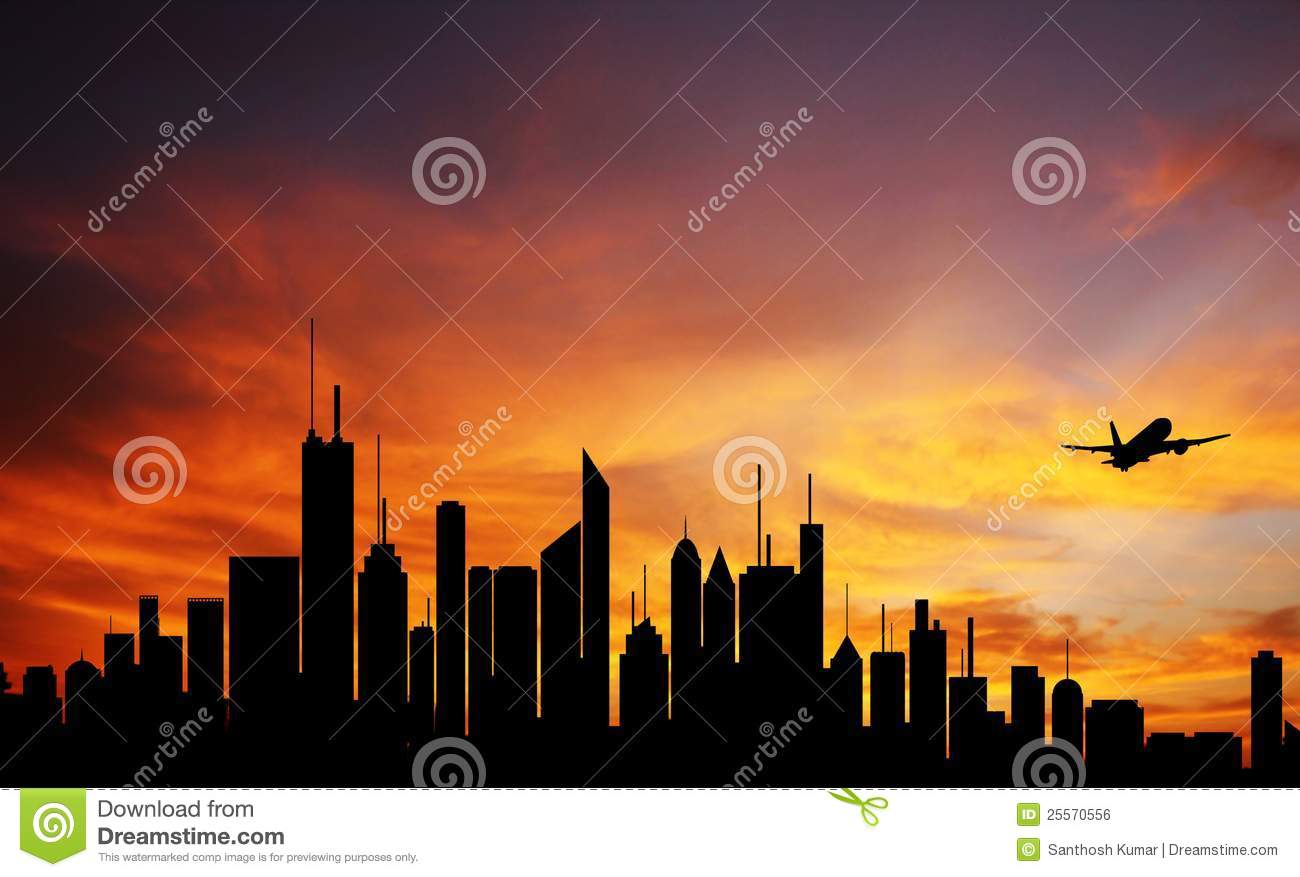 City downtown at dawn, skyline silhouette & plane