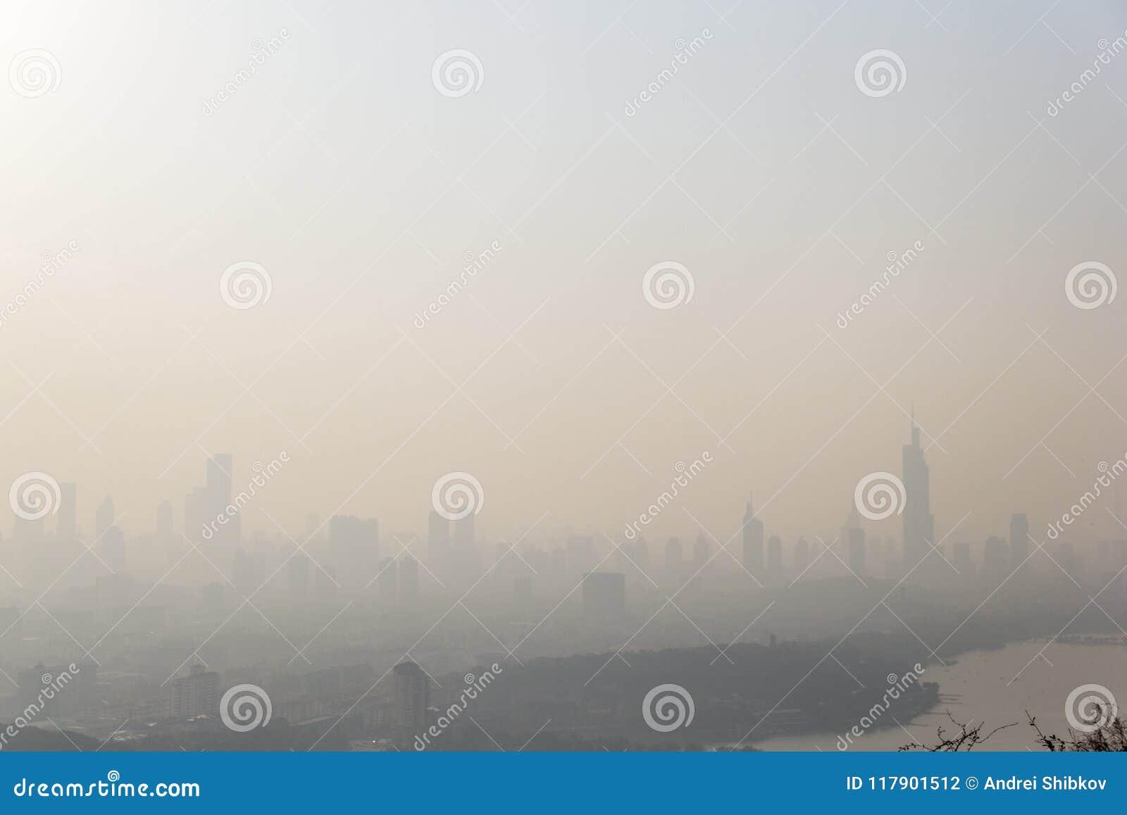 City landscape of Nanjing in China in fog