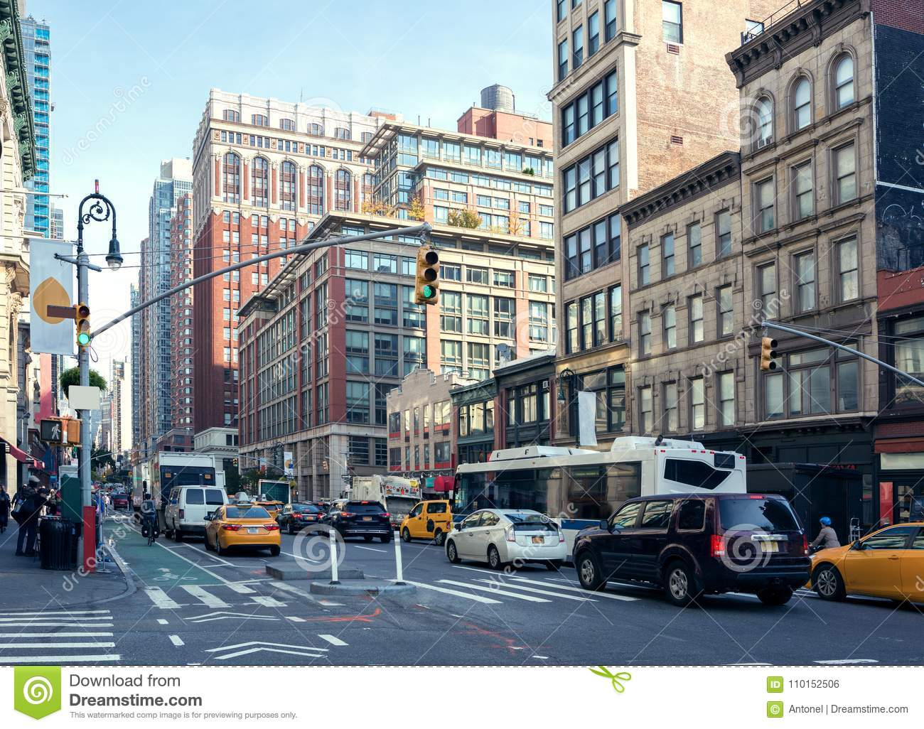City Life and traffic on Manhattan avenue Ladies` Mile Historic District at daylight , New York City, United States.